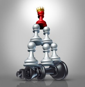Collaboration strategy and team victory as a business concept with a chess game metaphor for changing market leadership by teaming up in partnership and working together to dominate a powerful competitor.